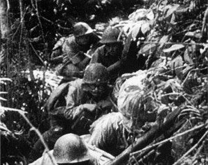 In a still shot from a captured film, Japanese soldiers, camouflaged to blend in with the dense jungle of Guadalcanal, advance stealthily toward American positions on the island in the Solomons.