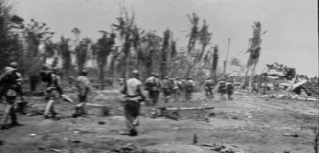 Ready for action against an unseen enemy, a U.S. Marine patrol moves out near the Matanikau River on Guadalcanal.