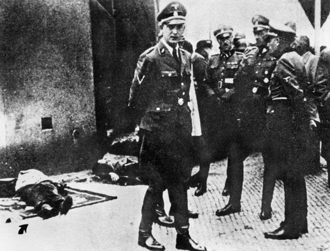 Karl Hermann Frank and other high-ranking Nazi officers examine the bodies of the Czech partisans they had surrounded in a Prague church. opposite: Following the assassination of Reinhard Heydrich, eight Czech partisans were tracked to the Church of St. Cyril and Methodius in Prague after they were betrayed. Surrounded, the Czechs resisted but were eventually either killed by the Germans or committed suicide rather than surrender.