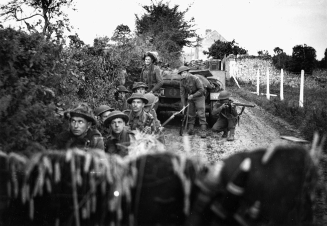 Taking cover from a German mortar barrage on Huly 10 1944, troops of the 130th Brigade, 43rd (wessex) Division await the inevitable explosion of the lethal shells.