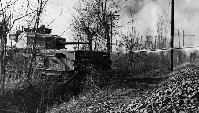The Crocodile, a Churchill tank modified to employ a flamethrower and tow its own tank of flammable liquid, was utilized in Normandy against fixed German positions. The Crocodile was capable of spewing its flames a distance of 120 feet.