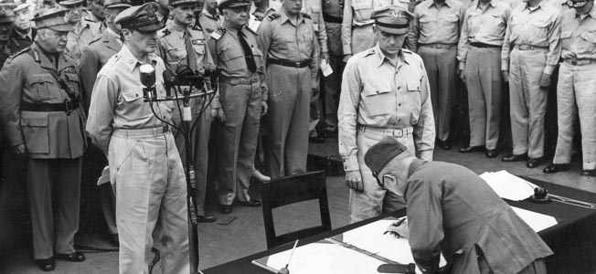 Army Chief of Staff Yoshiro Umezu signs the instrument of surrender on September 2, 1945, aboard the USS Missouri in Tokyo Bay. Prior to the war, many of the hawks among the Japanese leadership had been senior army officers.