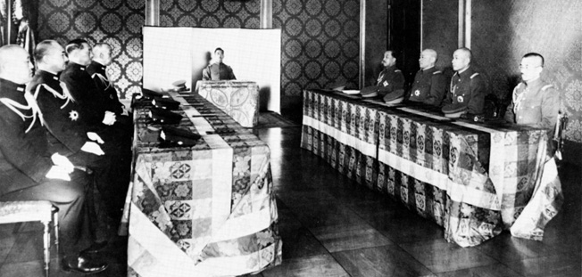 In discussions with the Supreme Council for the Direction of the War, Emperor Hirohito conducts a meeting in an underground air raid shelter, safe from American bombers.