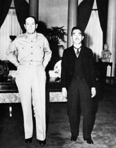 Following their first meeting, General Douglas MacArthur (left) and Emperor Hirohito pause for photographers on October 10, 1946.