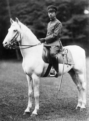 Wearing the uniform of the Imperial Japanese Army, Emperor Hirohito astride his stallion, White Snow, reviews troops in this prewar photograph.