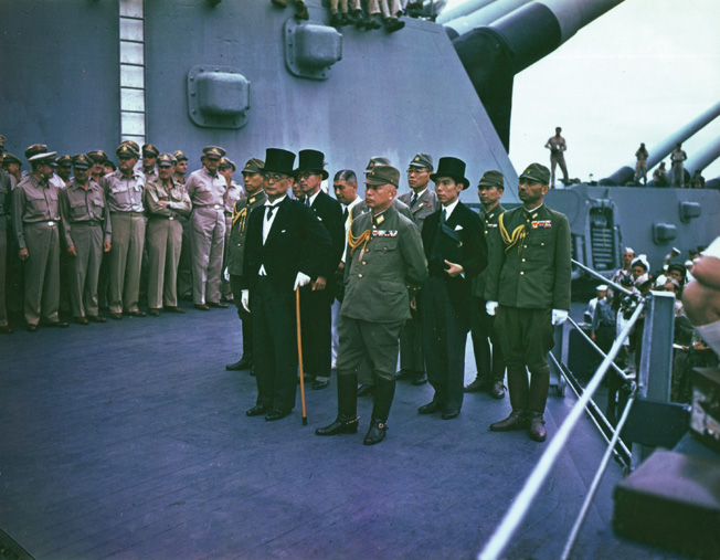 The Japanese delegation during the surrender proceedings aboard the battleship USS Missouri on September 2, 1945, included Foreign Minister Mamoru Shigemitsu and Army Chief of Staff Yoshijiro Umezu (front, left to right). Behind them stand, left to right, Major General Yatsuji Nagai of the Imperial Japanese Army, Katsuo Okazaki of the foreign ministry, Rear Admiral Tadatoshi Tomioka of the Imperial Japanese Navy, Toshikazu Kase of the foreign ministry, and Lieutenant General Suichi Miyakazi of the Imperial Japanese Army.