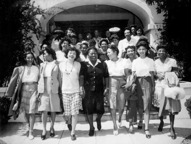 Famous for her Oscar-winning role in Gone with the Wind, actress Hattie McDaniel (center) served as chair-person of the Negro Division of the Hollywood Victory Committee. Here she leads a group of performers to Minter Field to entertain the troops stationed there.