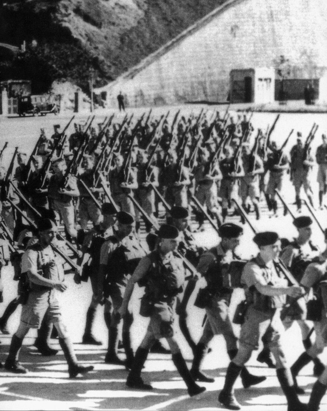 After landing in Hong Kong, Canadian troops march to join the garrison and continue training.