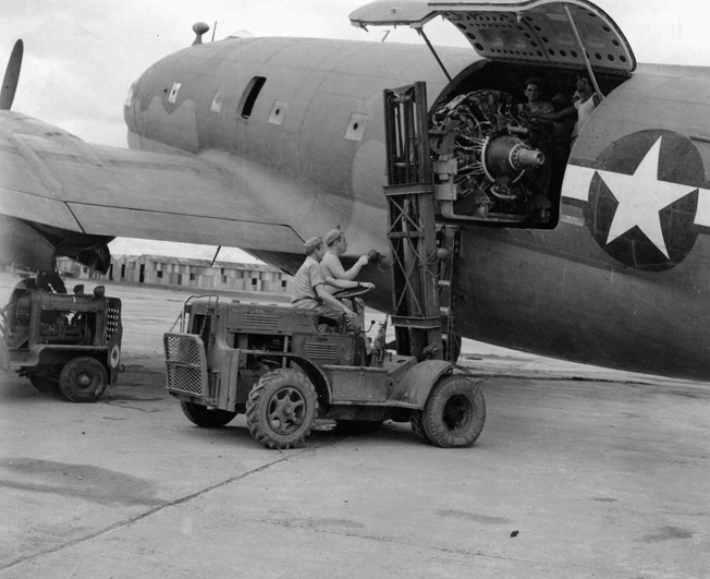 A replacement engine for a Boeing B-29 heavy bomber arrives in China aboard a C-46 transport. B-29 engines and replacement parts were a priority for Hump flights during the effort to mount a bombing campaign against Japan from airfields in China.