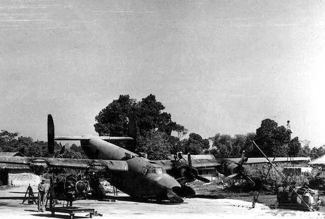 A C-87 transport, which has crashed at an airfield in India, is salvaged by ground crewmen in the hopes that it will be airworthy once again. The C-87 was the transport version of the B-24 Liberator heavy bomber.