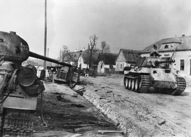 """Hungary: January 20, 1945. A German panzer V 'Panther' of a Waffen SS unit moves on a village street during the combat of the German offensive 'Konrad III', the aim of which was to capture besieged Budapest. ©SZ Photo / Scherl / The Image Works NOTE: The copyright notice must include """"The Image Works"""" DO NOT SHORTEN THE NAME OF THE COMPANY"""
