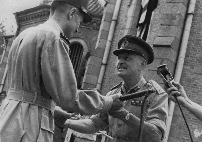British General Douglas Gracey (right) relinquishes command in Vietnam to French General Jacques Leclerc. Various political factions vied for control of the country, and the situation was precarious for the French after World War II.