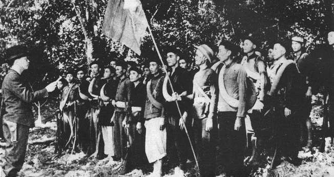 Vietnamese General Vo Nguyen Giap inspects Viet Minh soldiers during their fight against the occupying Japanese in 1944. Giap and the Viet Minh later turned their nationalism fueled by Communist doctrine against the colonial French and then the United States.