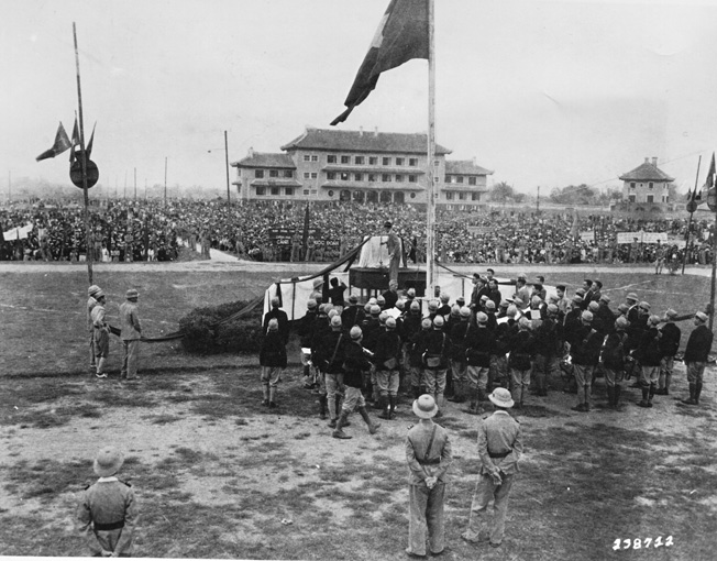 As the end of Japanese domination was becoming readily apparent, Viet Minh soldiers and supporters hold a public rally in the Indochinese city of Hanoi in March 1945.