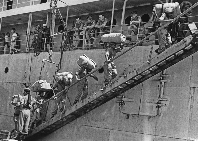 INDOCHINA, 1946. British troops of the 2/8 Punjab Regiment boarding a ship in Indochina bound for India. Photograph, May 1946.