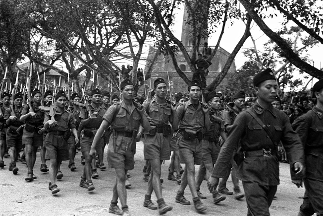 VIETNAM - APRIL 01: On April 1946, When The Contries Forming Indochina Were Negotiating Their Independence From France, Ho Chi-Minh Troops Paraded Through Hanoi. (Photo by Keystone-France/Gamma-Keystone via Getty Images)