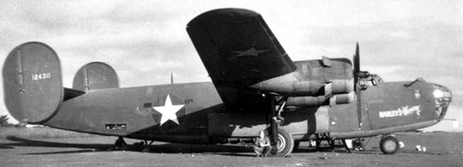 Hadley's Harem, sits on a runway at an airfield prior to a mission.