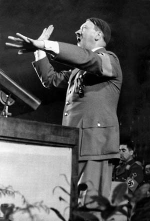 "Berlin, Germany: 1936. Adolf Hitler during his speech at the opening of the Winter Relief Organization in 1936 in the Berlin Sports Palace. ©SZ Photo / Scherl / The Image Works This image has been manually retouched by the original source NOTE: The copyright notice must include ""The Image Works"" DO NOT SHORTEN THE NAME OF THE COMPANY"