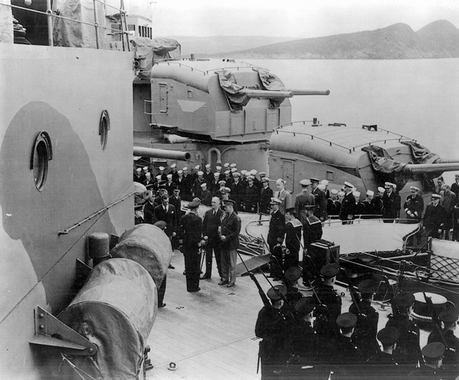 Arriving aboard the battleship HMS Prince of Wales, President Franklin D. Roosevelt is set to begin the historic Argentia Conference with British Prime Minister Winston Churchill.