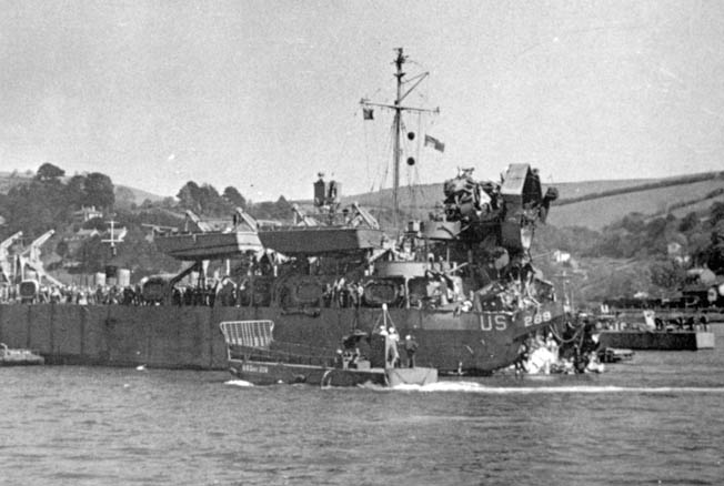 LST 289 (Landing Ship, Tank) lies in the harbor at Dartmouth, England, following the devastating attack by German E-boats during Exercise Tiger on the night of April 27, 1944.