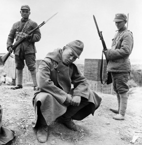 Crouching before his Chinese captors, a dejected Japanese soldier awaits his fate at Changde in Hunan Province. This soldier was captured as the Chinese advanced on February 1, 1944. (Bettmann/CORBIS)