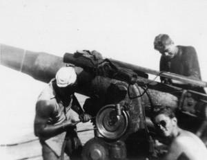 Aboard the merchant ship SS O.M. Bernuth, members of the vessel's Naval Armed guard operate a 4-inch gun.