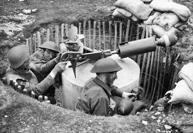In this May 1943 photograph, a trio of Home Guardsmen train with a Blacker Bombard spigot mortar. Although supplies and weapons were limited in the early months of the Home Guard's activities, they were better armed as World War II progressed.
