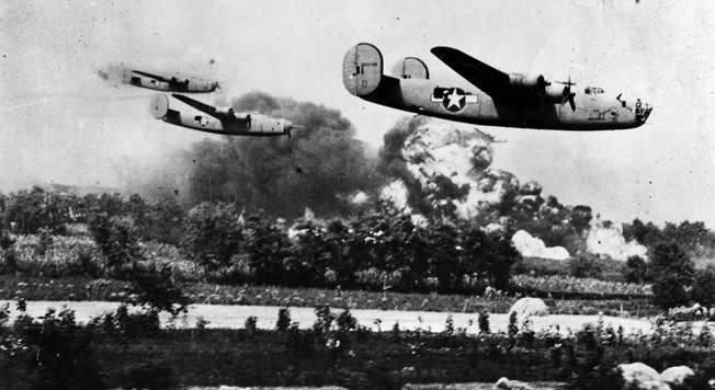 Pilots and crewmen of B-24 Liberator heavy bombers brave enemy fire and fly low toward their target during the costly Ploesti raid.