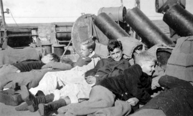 Five of the rescued boys that survived the  sinking of the SS City of Benares rest on the deck of the destroyer HMS Anthony after their rescue from the waters of the Atlantic Ocean.