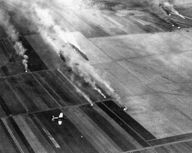 A plane from the 4th Fighter Group attacks a German airdrome near Leipzig in February 1945.