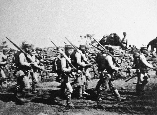 Marching near the village of Chemulpo, Korea, these Japanese soldiers are advancing toward their Russian enemy during the Russo-Japanese War in September 1904.