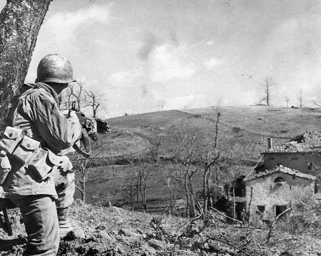 After the Allied campaign to penetrate the Gothic Line in the autumn of 1944 failed, the front lay dormant until February 1945, when a new, ultimately successful, offensive began. Here a member of the 10th Mountain Division, which spearheaded the new offensive, covers his buddies approaching a German-held farmhouse.