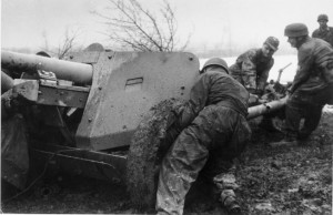 Preparing one of their defensive lines intended to slow the dogged Allied advance into northern Italy, fatigued German airborne troops, or Fallschirmjäger, manhandle an artillery piece into position. This photo was taken in February 1945.