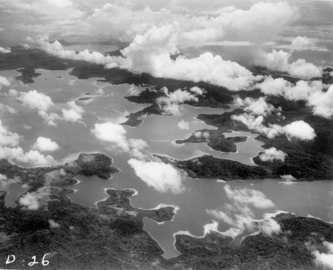 This aerial view of Tulagi island in the Solomons chain illustrates the close nature of the waterways in the southern area of the archipelago. LST-449 was steaming toward nearby Guadalcanal when the vessel entered the combat zone.