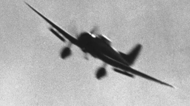 A Japanese Aichi D3A Type 99 dive bomber is caught in flight by a photographer in a nearby aircraft.