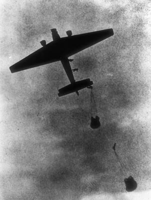 A Junkers Ju-52 transport drops airborne troops and supplies during Operation Mercury, the invasion of Crete.