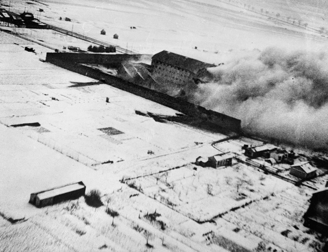 This photograph taken by one of the attacking planes of No. 464 Squadron Royal Australian Air Force shows smoke rising thickly from the damaged north and east wings of Amiens Prison. The Australians participated in the second wave of Operation Jericho, while the Germans were on full alert.