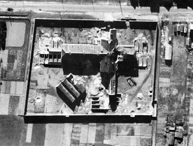In this reconnaissance photo taken from nearly directly above the prison at Amiens, damage to the north wall is visible at lower right. A large section of the wall collapsed under the impact of 500-pound bombs during the raid which took place on March 23, 1944.