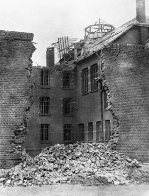 This photo, taken from inside Amiens Prison after the Operation Jericho raid, reveals serious damage to the complex. The junction of the north and west wings of the prison has been struck by several bombs. The photographer's back is to the large breach which was blasted in the outer west wall of the prison.