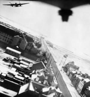 Mosquitos of No. 487 Squadron Royal New Zealand Air Force clear the walls of Amiens Prison after dropping their 500-pound bombs on the facility. The first explosions are visible, striking near the south wall of the prison.