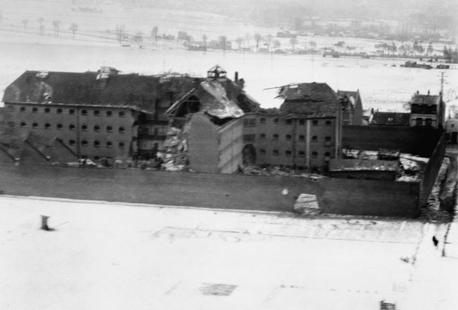 Two days after the raid, a low-level reconnaissance photo reveals extensive damage to Amiens Prison. The Operation Jericho raid to free prisoners from the Germans blasted a breach in the north wall of the facility, which is visible at the center of the image.