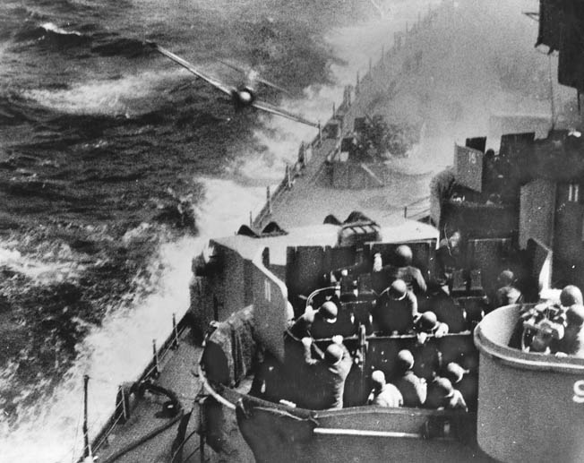 Ferocious attacks by Japanese planes took a heavy toll in lives and damaged dozens of U.S. Navy vessels during operations to capture the island.