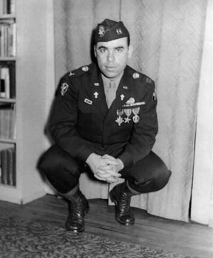 Father Francis L. Sampson is shown still in uniform and holding the rank of captain following his return from Europe after World War II. The Distinguished Service Cross, Bronze Star, and Purple Heart are among the decorations visible on his uniform.