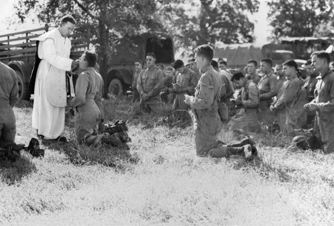 Troopers of the 501st Parachute Infantry Regiment receive Holy Communion from Father Sam during Second Army Maneuvers No. 3, held in Tennessee during September through November 1943. Thirty-one percent of the airborne troopers in the 501st were Roman Catholic.
