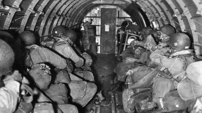 Paratroopers from Headquarters Company, 501st on their way to Normandy. First Lieutenant Foster G. Beamsley (Assistant Regimental S-2) served as jumpmaster aboard this C-47 from the 99th Troop Carrier Squadron. The 99th led the 441st Troop Carrier Group to France.