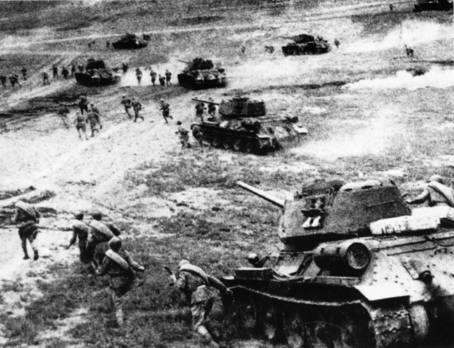 Soviet T-34 tanks, supported by thousands of Red Army soldiers, advance rapidly during a counter-attack at Kursk.