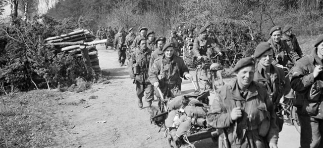 Advancing near Brelingen, Germany, on April 10, 1945, these British paratroopers of the 6th Airborne Division are using handcarts and bicycles to facilitate their forward movement.