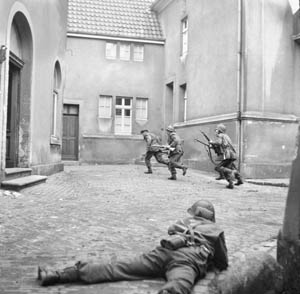 British infantrymen of the 3rd Division root out snipers in the city of Lingen, Germany, on April 7, 1945.