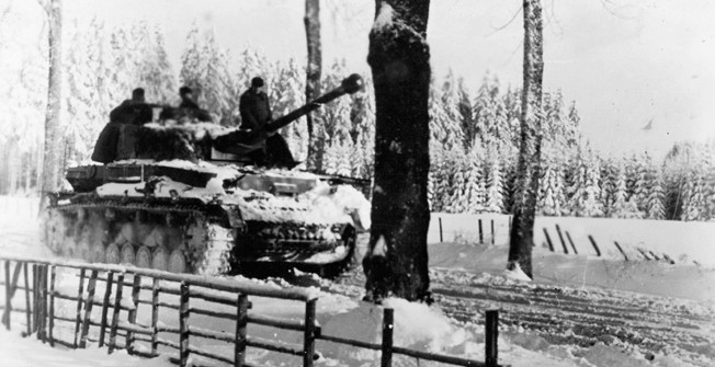 German Panzer IV tank of a Waffen-SS division passing snowy roads in France during the Battle of the Bulge, World War II, 29 January 1945.