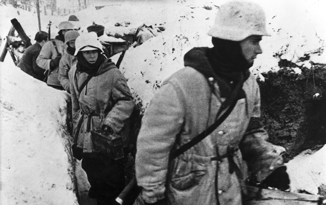 On September 2, 1943, German soldiers, camouflaged against the snow, which already blankets the ground, move forward. Alert to the potential Soviet offensive that was to come, the Germans took a heavy toll in Russian casualties, both military and civilian.
